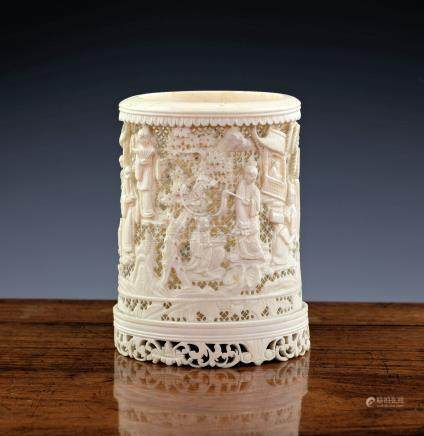 A 19th century Chinese Canton carved and pierced ivory brush pot, carved with figures and