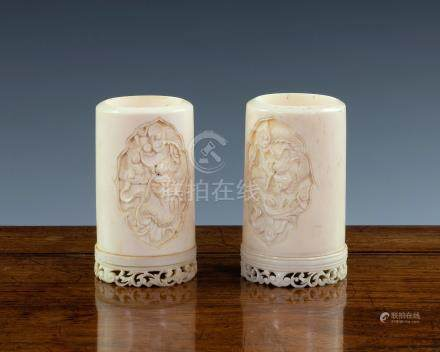 Two small Chinese Canton carved ivory brush pots, 19th century, both carved with two shaped reserves