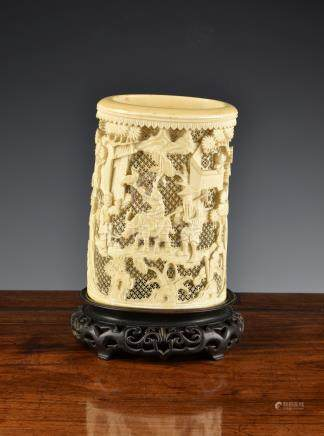 A Chinese Canton carved and pierced ivory brush pot, 19th century, oval form, carved with figures