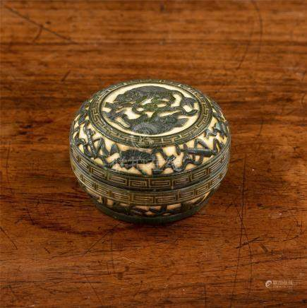A Chinese carved and stained ivory box and cover, Qing Dynasty, of bun form on short, circular foot,