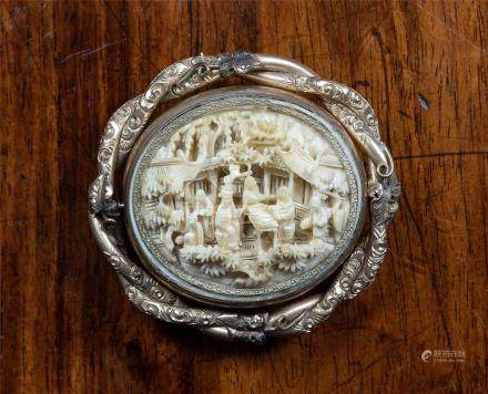 A Chinese Canton carved ivory brooch, late 19th century, the oval plaque carved with figures on a