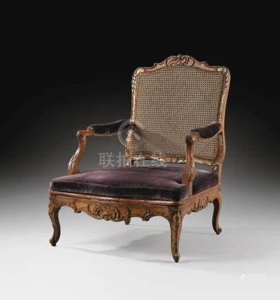 A large caned beechwood armchair, early Louis XV