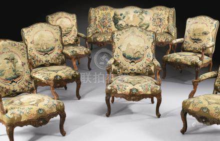 A French Louis XV carved tinted beechwood salon suite, including a sofa and six armchairs