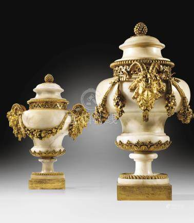 A pair of Louis XVI gilt-bronze mounted alabaster pots-pourris vases