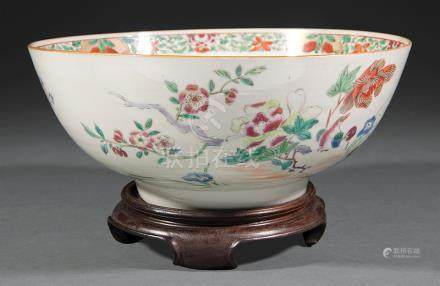 Chinese Export Famille Rose Porcelain Punch Bowl, Qing Dynasty (1644-1911), painted with a pair of
