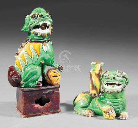 "Two Chinese ""Sancai"" Glazed Porcelain Buddhist Lions, Qing Dynasty, 18th c., one modeled crouching"