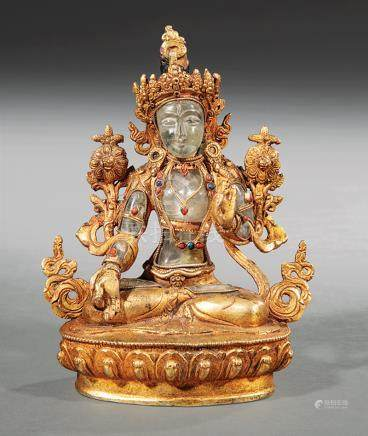 Tibetan or Nepalese Gem Embellished, Polychrome and Gilt Metal-Mounted Rock Crystal Figure of