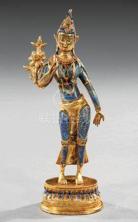 Tibetan Gem Embellished and Gilt Bronze-Mounted Lapis Lazuli Figure of Tara, modeled standing in