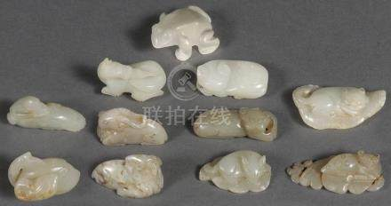 TEN CHINESE CARVED JADE PENDANTS