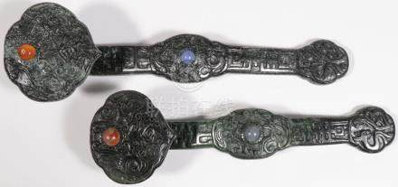 A PAIR OF CHINESE CARVED JADE RUYI SCEPTERS