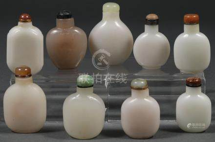 NINE CHINESE CARVED JADE SNUFF BOTTLES