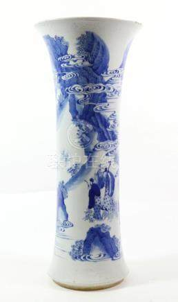 A Chinese Porcelain Beaker Vase, in Kangxi style, painted in underglaze blue with figures on a river