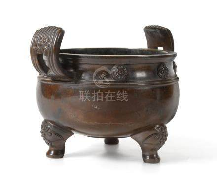 A Chinese Bronze Censer, Ding, bears six character Xuande reign mark, of ovoid form with reeded loop