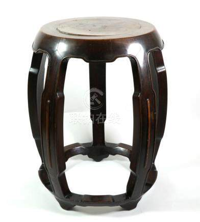 A Chinese Hardwood Barrel Stool, Qing Dynasty, on five curving supports with peripheral stretcher,