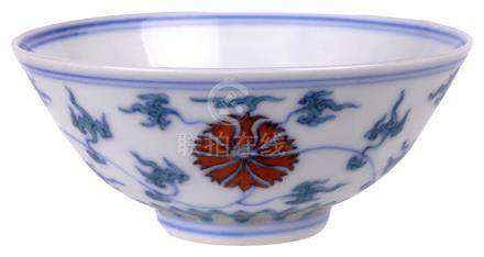 A CHINESE DOUCAI 'LOTUS' BOWL circular on rim foot, painted to the exterior with a stylised