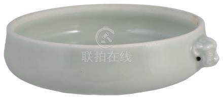 A CHINESE PORCELAIN BOWL, GUANGXU MARK AND PERIOD (1875-1908) covered in a pale celadon glaze, of