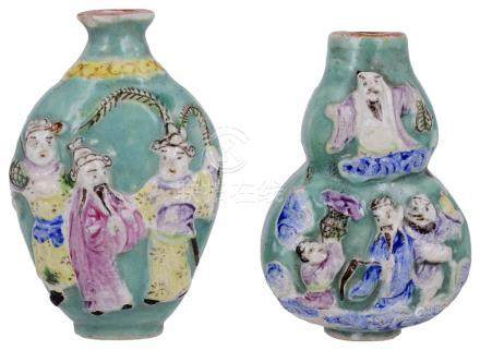 TWO CHINESE FAMILLE ROSE PORCELAIN SNUFF BOTTLES, 20TH CENTURY double gourd ovoid, each moulded in