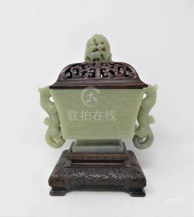 A CHINESE CELADON JADE ARCHAISTIC 'TAOTIE MASK' INCENSE BURNER the flaring rectangular body rising