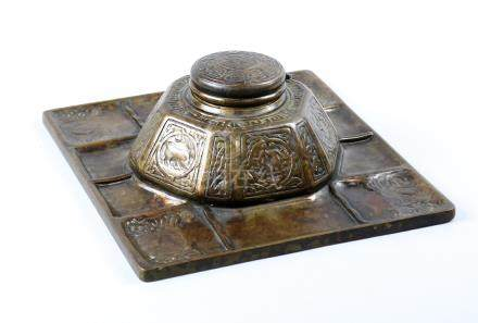 Tiffany Studios patinated bronze Zodiac inkwell, the hexagonal well with alternating figural and