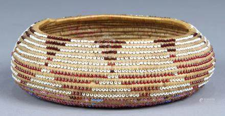 Northwest California Pomo coiled basket, 20th century, having polychrome glass beads integrated into