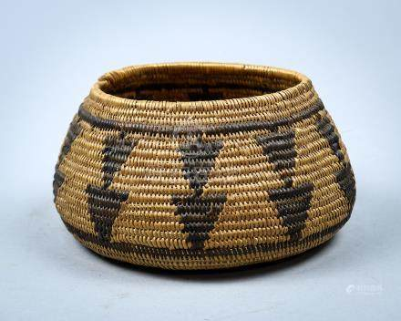 Southern California Mission coiled basket, 19th century, having a bulbous form with continuous woven