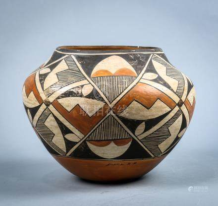 Acoma pottery olla or water jar, early 20th century, having a shouldered form with a geometric paint