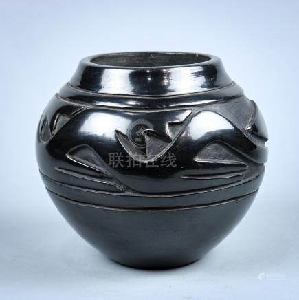 Santa Clara or San Ildefonso blackware vessel, having relief carved arrow motifs, signed