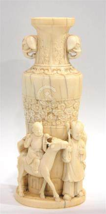 An Ivory Rouleau Shaped Vase, with Fine Carving of Children