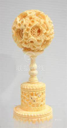 A Chinese Ivory Puzzle Ball, Carved & Pierced with Writhing