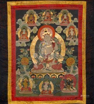 A Tibetan Thangka, Gouache on Canvas with Silk Border & Cott