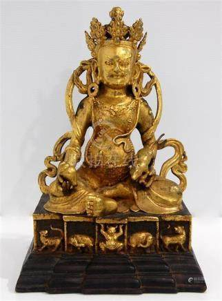 A Sino-Tibetan Gilt Bronze Alloy Jambhala, Seated in Royal E