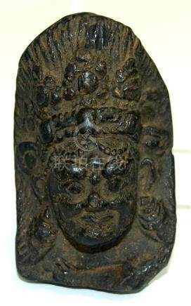 A Mask of Bhairava in Black Clay, Wearing an Aureole of Danc