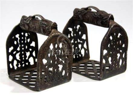 A Pair of Tibetan Iron Stirrups with Pierced Open Work & Chi