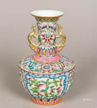 A Chinese porcelain twin handled baluster vase Brightly enam