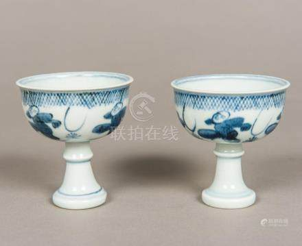 A pair of Chinese blue and white porcelain stem cups Both fi