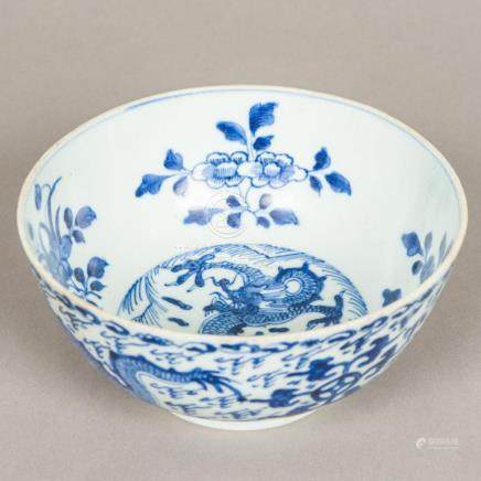 A Chinese blue and white porcelain bowl Worked with dragons