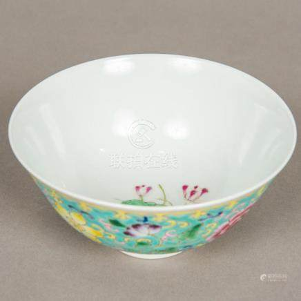 A Chinese porcelain bowl Worked with lotus strapwork on a tu
