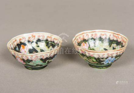 A pair of Chinese famille noir porcelain tea bowls Floral de