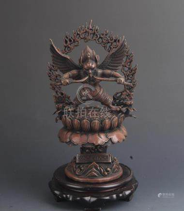 A TALL TIBETAN GARUDA STATUE