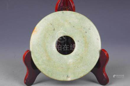 A FINELY CARVED OLD ROUND JADE