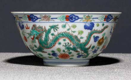 A FINE DRAGON BOWL, China, underglaze blue Daoguang seal mark and period - One half with re-stuck br