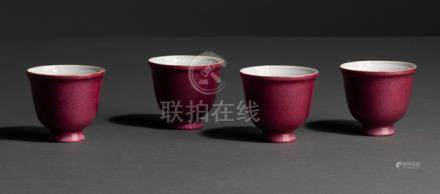 A SET OF FOUR PUCE-ENAMELLED PORCELAIN CUPS, China, Qianlong six-character seal marks in underglaze-