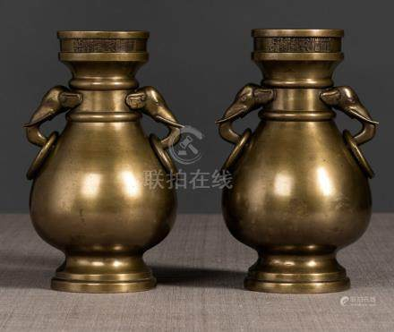 A PAIR OF BRONZE VASES WITH ELEPHANT RING HANDLES, China, cast Qianlong seal marks below the rim and