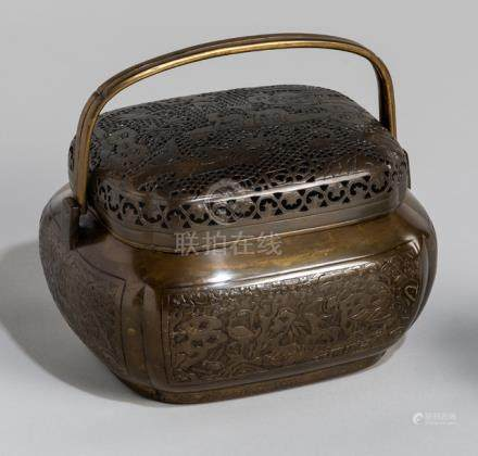 A BRONZE TRIPOD CENSER AND HAND WARMER, China, 19th ct. The tripod censer with a band of floral scro