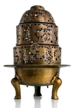A LARGE BRASS AND COPPER STOVE, China, 19th ct. The tripod base with a four-part top, decorated with