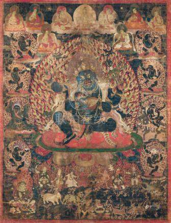 A FINE AND RARE THANGKA OF THE PROTECTOR DEITY CATURBHUJA-MAHAKALA, Tibet, 16th ct., framed under gl