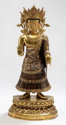 A GILT-BRONZE FIGURE OF THE DIPANKARA BUDDHA, NEPAL, 20th ct., standing in samabhanga on a lotus bas