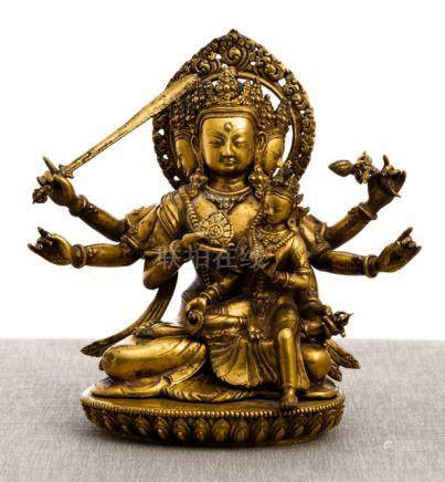 A GILT-BRONZE FIGURE OF MANJUGOSHA, NEPAL, 17th/18th ct., seated in vajrasana on a lotus base with h