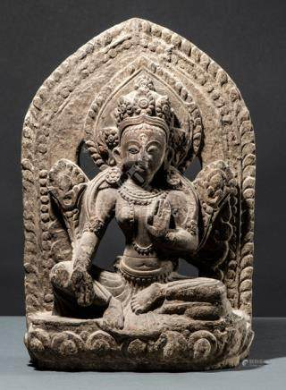A STONE FIGURE OF A TARA, NEPAL, 17th/18th ct., seated in rajalilasana on a lotus base with both han