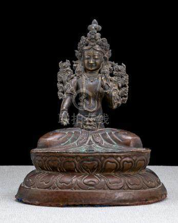 A COPPER EMBOSSED FIGURE OF SITATARA, NEPAL, late 18th ct., seated in vajrasana on a lotus base with